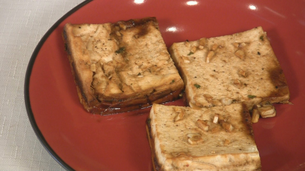 Try our Baked Tofu all slathered in flavor!